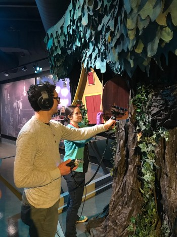 """History Center registrar Nicole Lauletta assists an """"A Beautiful Day in the Neighborhood"""" crew member, who records the sound of the living room door opening and closing. Fred Rogers came through this iconic door at the beginning of each episode of """"Mister Rogers' Neighborhood."""""""