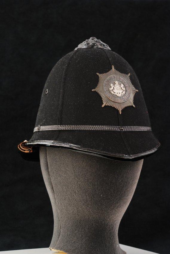 Black police helmet, c. 1906