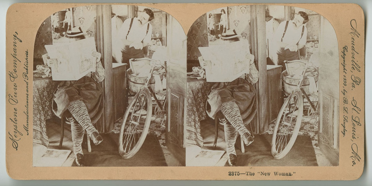 """""""The New Woman,"""" stereoview card, Keystone View Company, Meadville, Pa, c. 1899. Note the bicycle here, which like the shirtwaist, became a symbol of women's growing calls for a more independent life. Courtesy of the Library Company of Philadelphia, Print Department."""