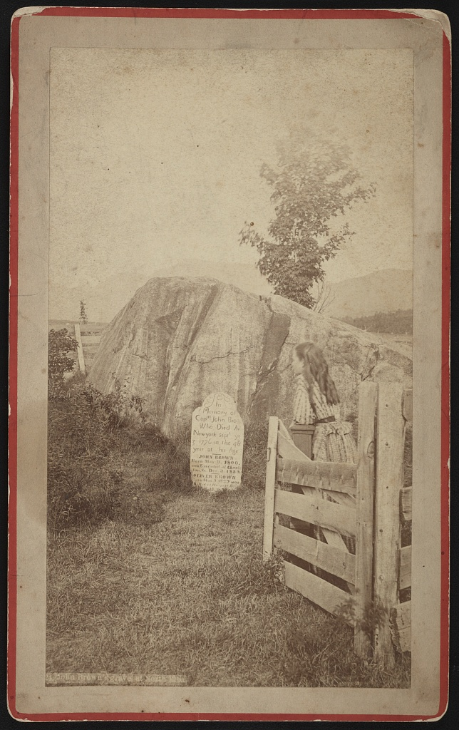 Commemorative photograph showing a little girl visiting John Brown's grave in North Elba, NY, between 1860-1880. Such images, like the print in the exhibit, were made for commercial trade. Courtesy of the Library of Congress, Prints and Photographs Division.