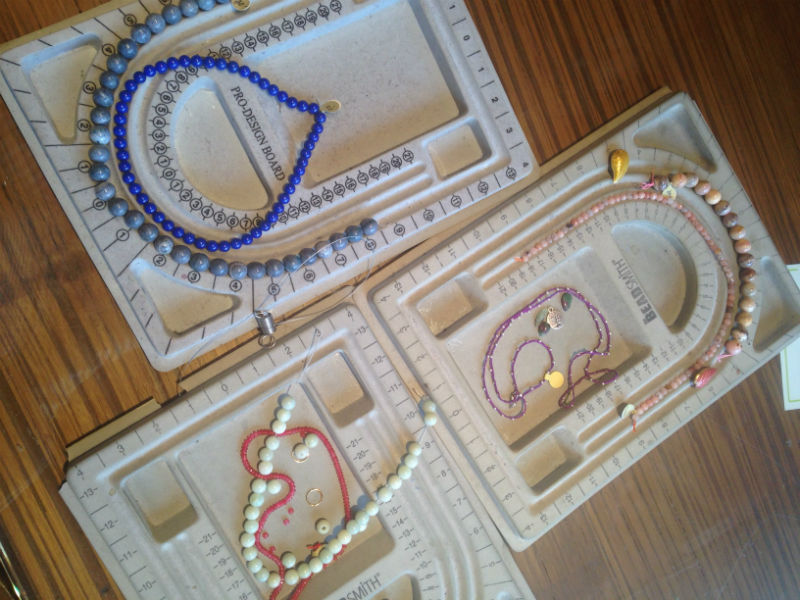 All three necklaces on trays