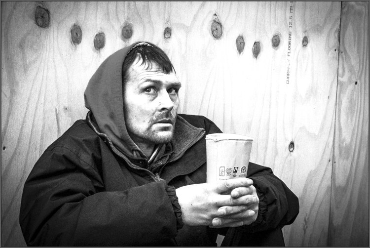 man with paper cup fl7web