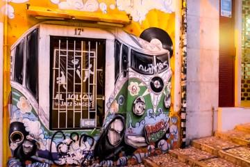 Entrance to Magic Bus Record Shop Lisbon dusk
