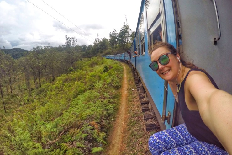 Sitting in the doorway of a train in Sri Lanka.