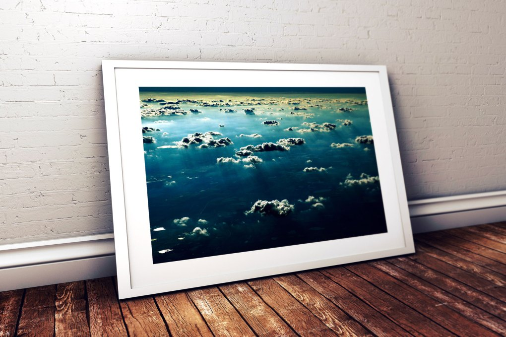 Jason Florio photography - Image of a framed print of blue sky and clouds, above Texas - taken from the window of a plane