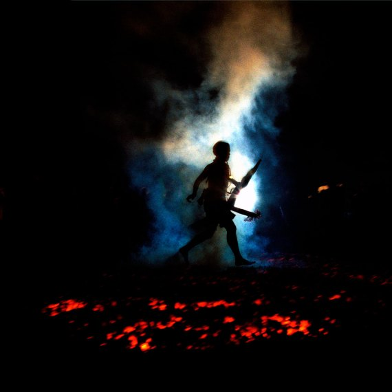 ©Jason Florio - Fire Walker, Thailand . Color-man walking across hot coals at a vegetarian ceremony in Thailand