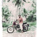#7 - ALSO IN INDIA © OSKAR LANDI. Color. Polaroid - Indian man sitting astride his motorcycle, palm trees in the background