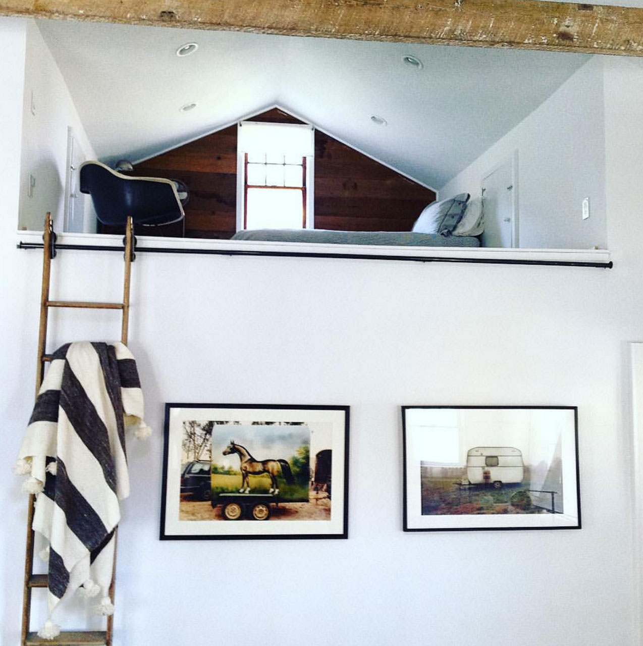 Image of two color photography prints on a wall - both by photographer, Jason Florio - one with a horse box, the other with a caravan , in the UK
