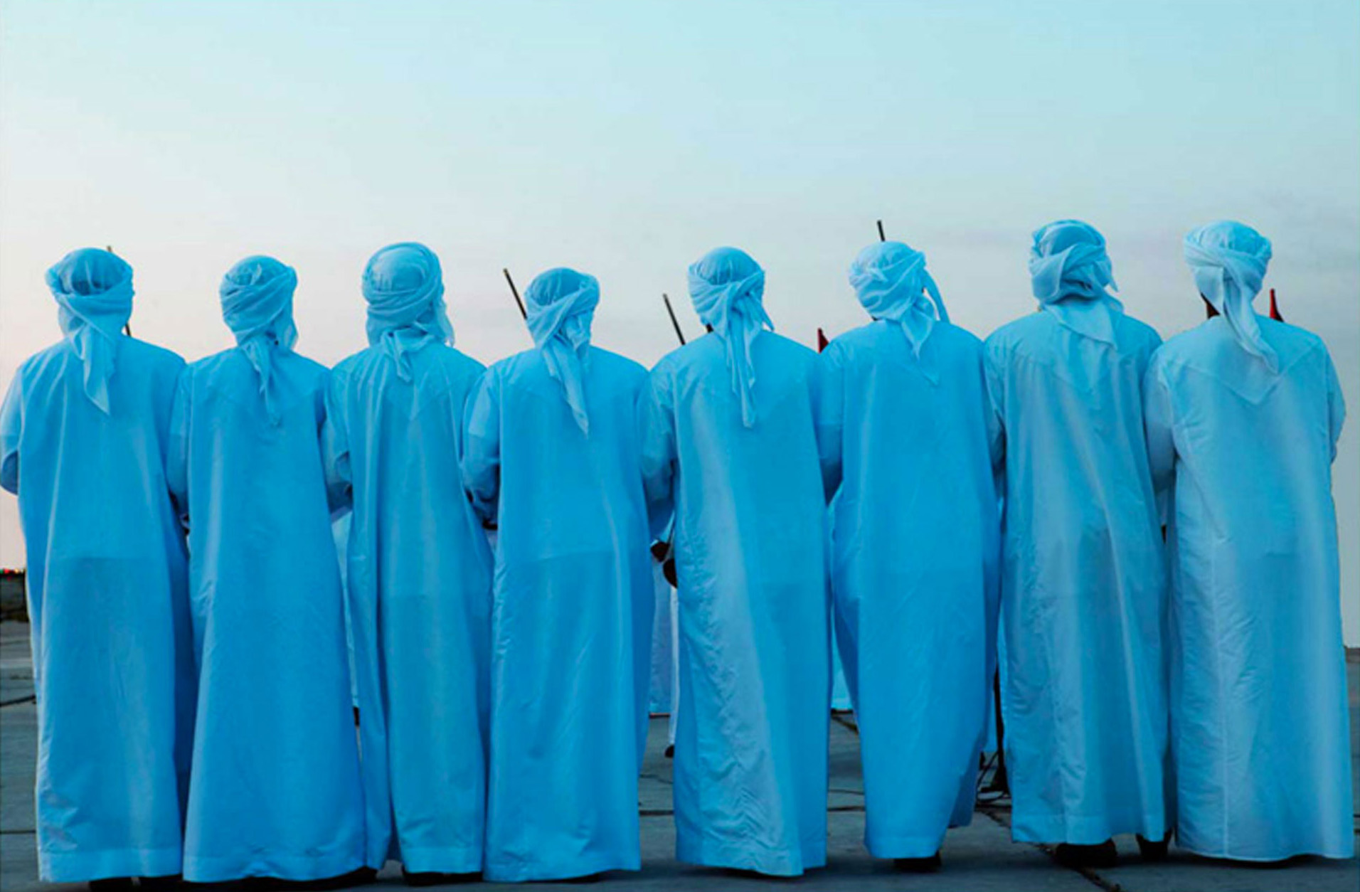 Jason Florio photographer - color image of a line of blue robed men, with their backs to the camera, ceremonial dance, Beirut