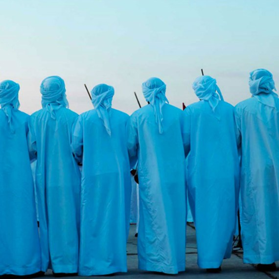 CEREMONIAL DANCE, BEIRUT © Jason Florio. Color-group of blue robbed men prepare for ceremony
