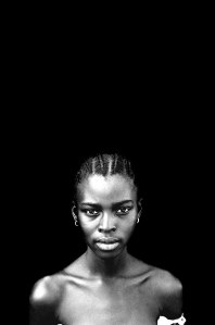'Ida' student, The Gambia, West Africa © Jason Florio. BW portrait of young girl against black background