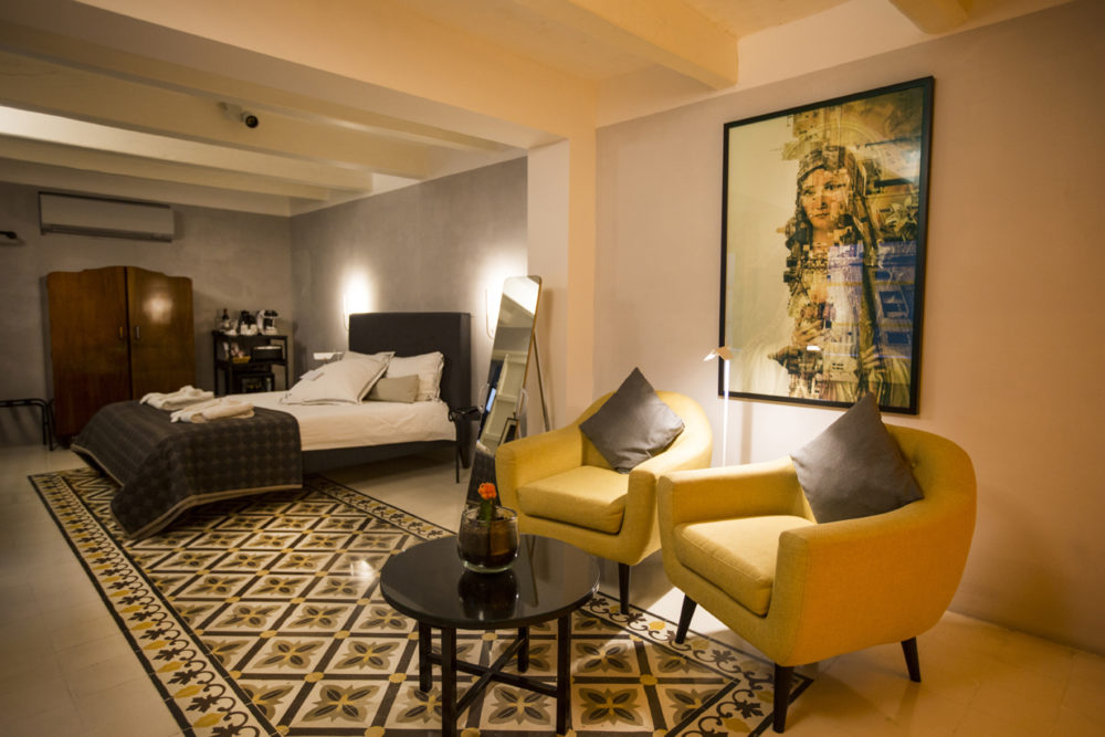 ©Ritty Tacsum 'Devotion', large framed print, on the wall of guest room, Casa Ellul hotel, Valletta