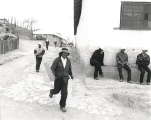 KWIRA (TARAHUMARA), MEXICO #152 © Oskar Landi. Black and white framed print, village scene, men walking and sitting around
