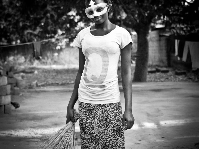 'Mask Girl' 2 The Gambia © Jason Florio-black & white. girl wearing mardi gras mask, West Africa