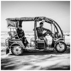 'Tuk Tuks' Bangladesh © Jason Florio. BW driver and passenger sit in a tuk tuk