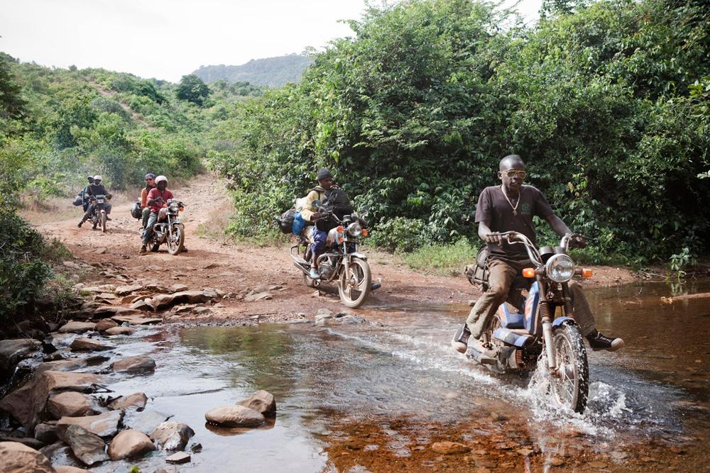 Photography Prints Gallery - 'Moto Taxis' Helen Jones-Florio and the expedition team, Fouta Djallon Highlands, Guinea-Conakry © Jason Florio