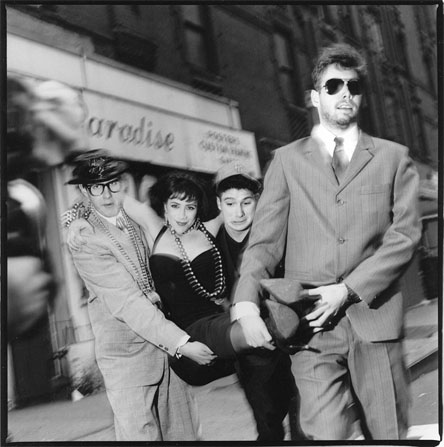 Photographers We Love Michel Delsol - The Beastie Boys, carrying on of their GoGo dancers, 'Eloise', Times Square, NYC