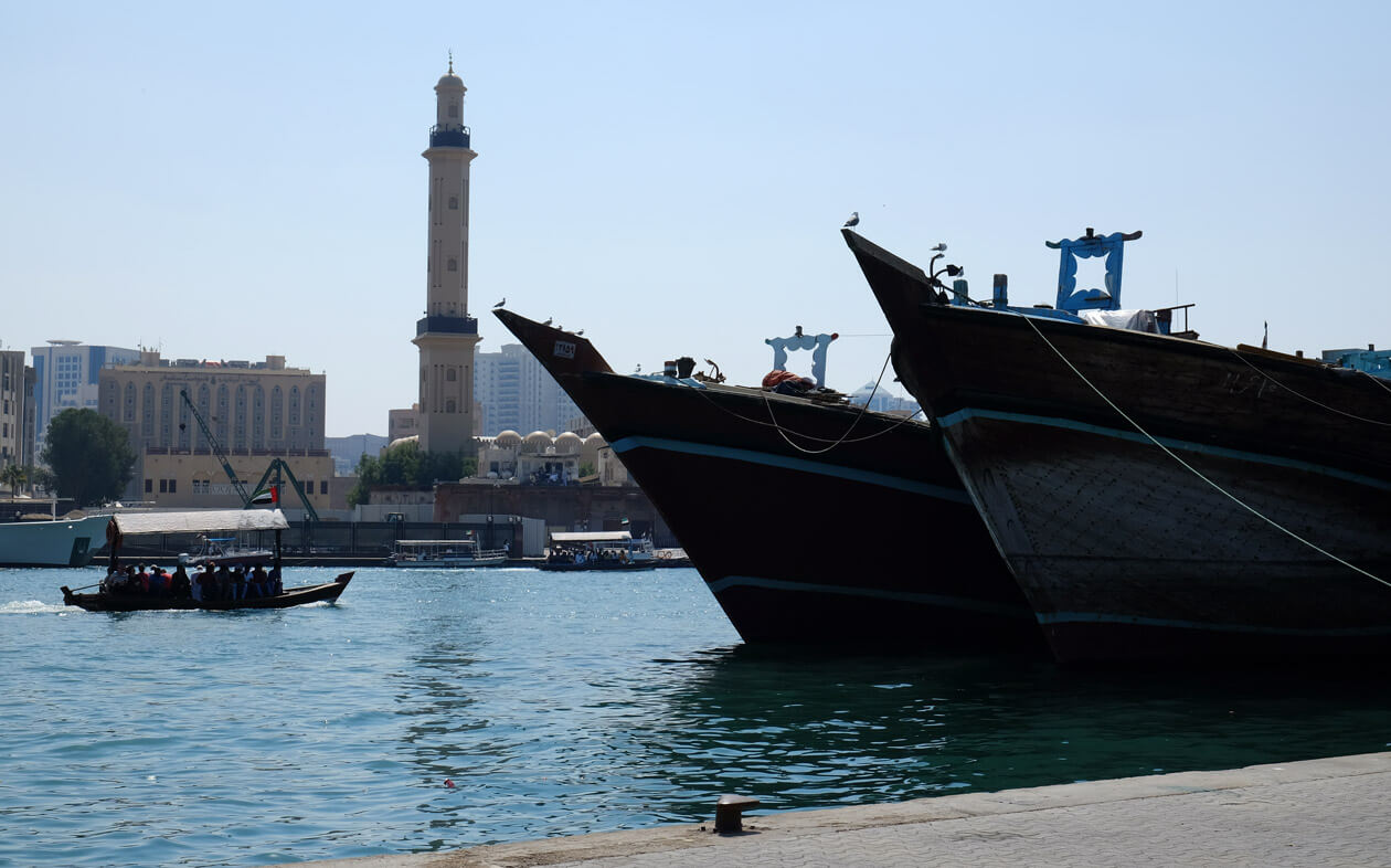 Dhows moored on the bank of the Dubai Creek