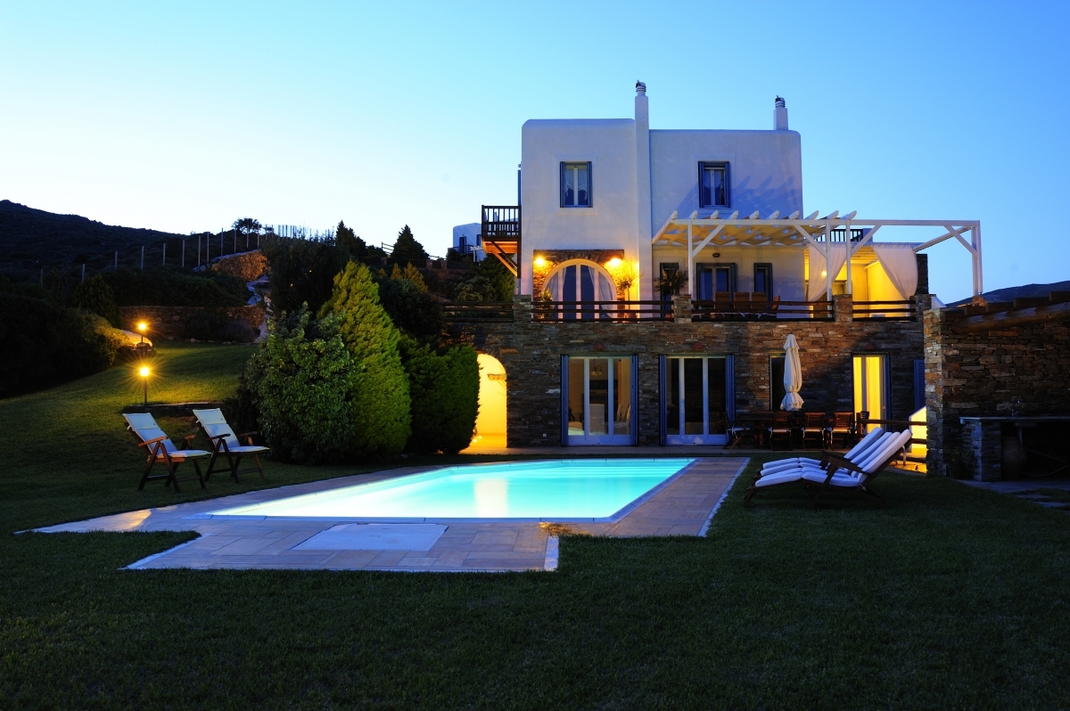 Romantic evening lights in our villa with pool