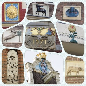 Wall plaques and decor on Amsterdam buildings