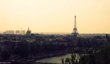 A photograph of the Eiffel Tower and the Left Bank in Paris, France, as seen from the terrace of La Samaritaine.