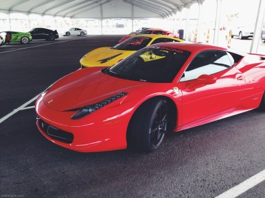 Cars sit in the pit area between outings at Exotics Racing, Las Vegas Motor Speedway.