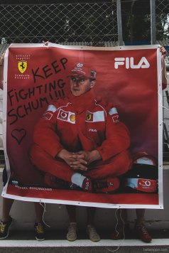 Ferrari fans show their support for former driver and multiple world champion Michael Schumacher.