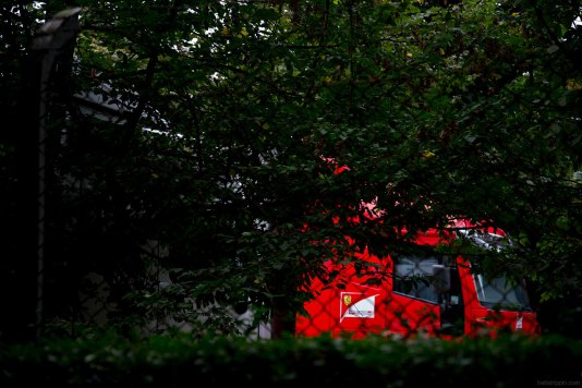 Walking through Parco di Monza, the vast parkland that surrounds the racetrack, I noticed a parking lot full of team transport vehicles—including this red Scuderia Ferrari team truck.