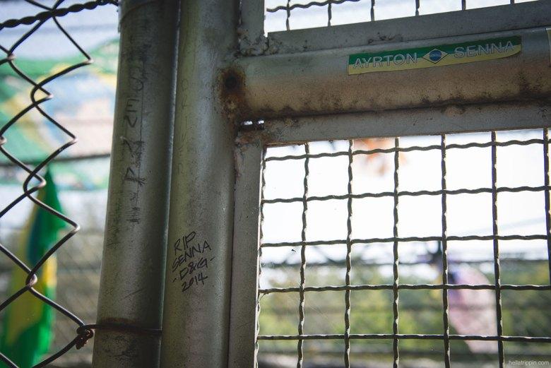 """The fencing of Autodromo Enzo e Dino Ferrari has a new inscription: """"R.I.P. Senna. D & G 2014."""""""