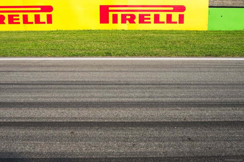Dark streaks of tire rubber remain on track along the main straight.