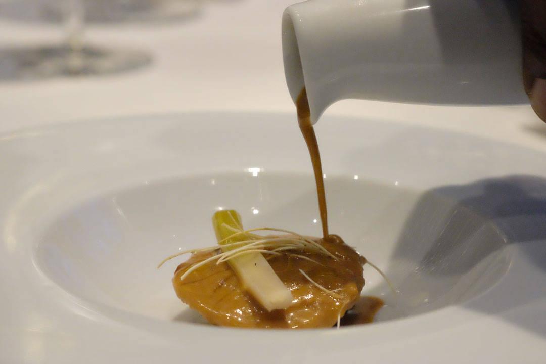 """Alaskan King Crab and Foie Gras Ravioli Stewed Leeks in Vinaigrette Lightly Creamed """"Lobster Jus – Soup"""""""