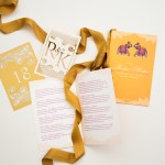 custom lasercut monogram, printed hindu wedding program with elephants, laser cut table numbers | AZURE
