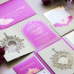 laser cut pink and purple invitation with gold foil printing
