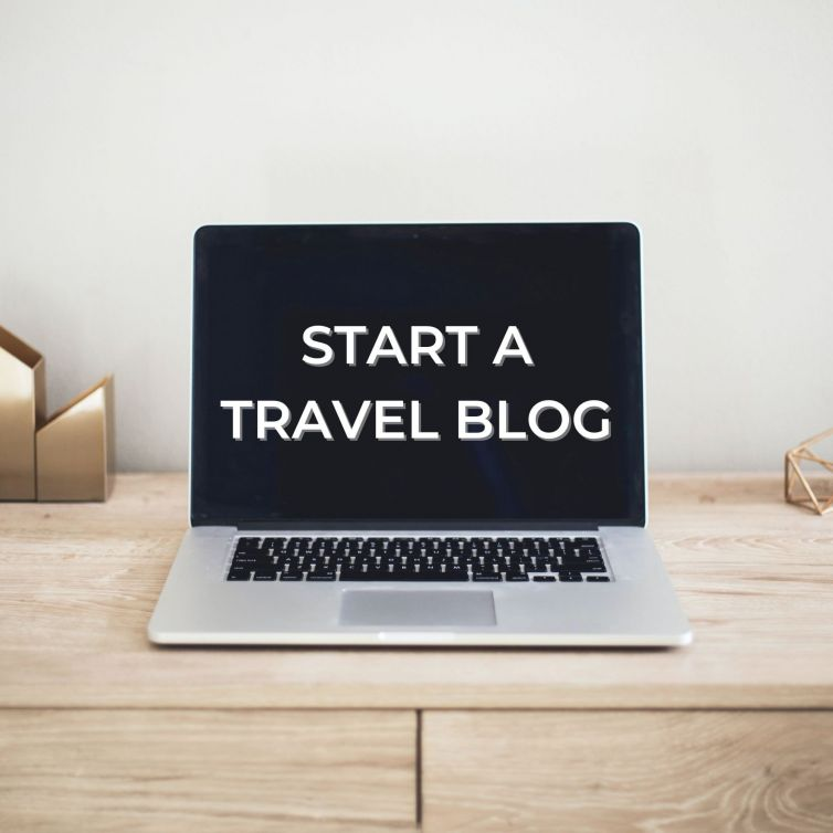 start a travel blog laptop screen