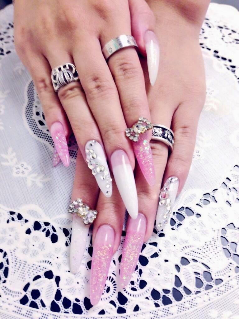 Long and dramatic diamante nail art