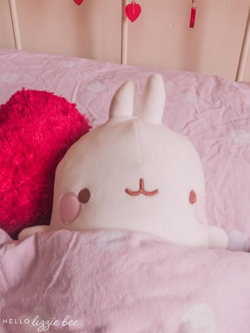 Kawaii Molang tucked into bed