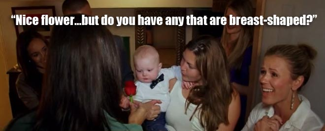 Desiree gives a rose to a baby as Trista watches on the bachelorette men tell all.