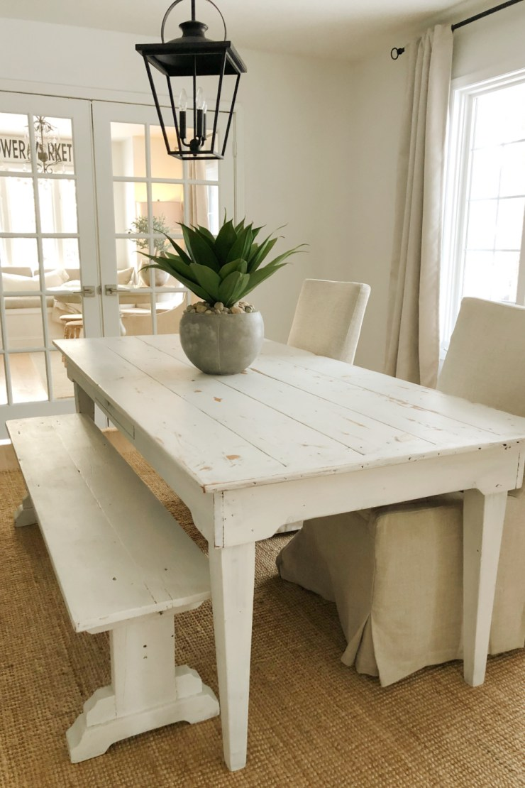 """Simple spare and natural dining room with farm table and 24"""" artificial agave potted succulent- Hello Lovely Studio."""