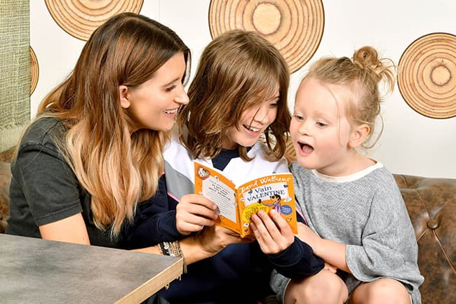 charley-webb-reading-with-sons