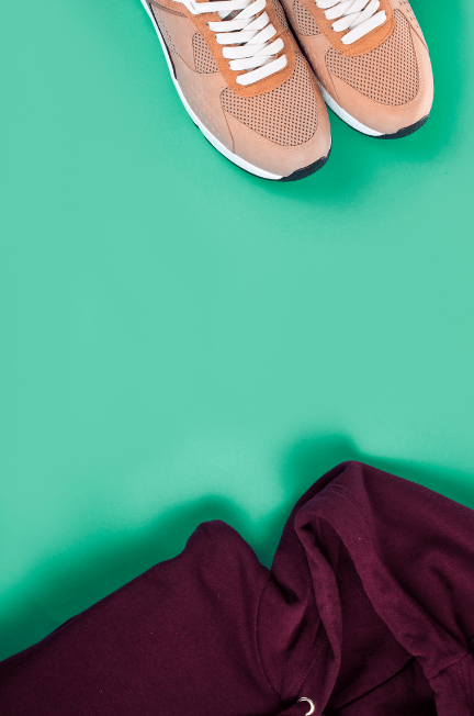 burgundy clothing and light apricot runners on a sea foam green background
