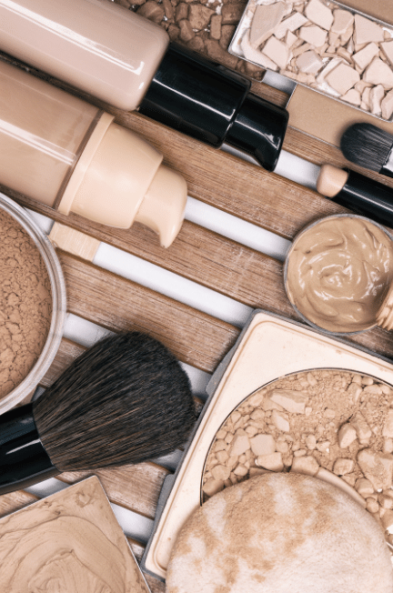 Foundation and neutral colored makeup with brushes