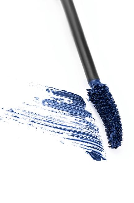 mascara wand with blue formula on it