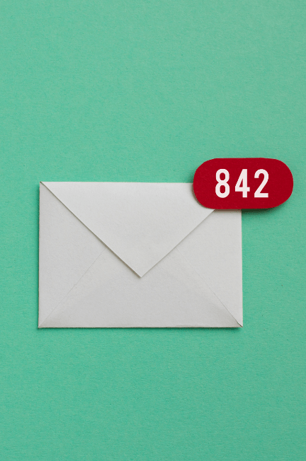 """envelope with red bubble that says """"842"""" on the side in front of mint green background"""