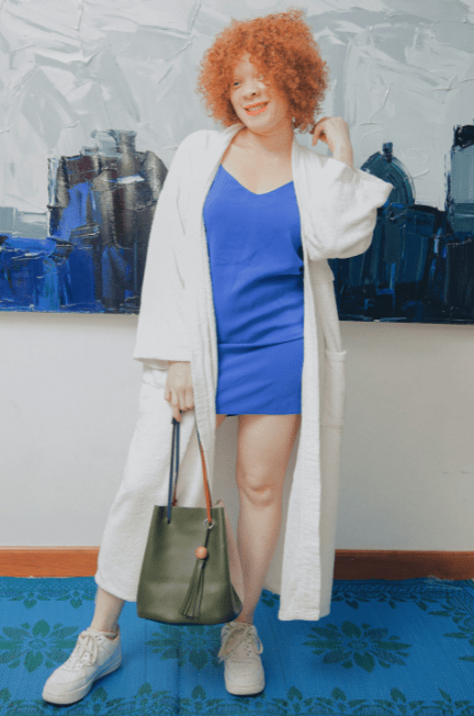 Woman in a blue dress with a white robe on