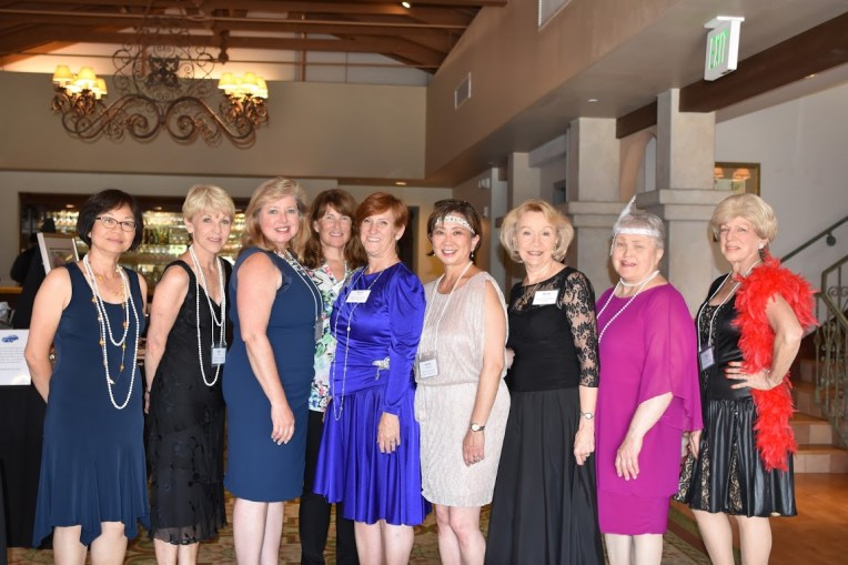 Some of the H.E.L.P. gala committee members, from left: Yim Hom, Sally Moton, Linda Cochrane, Hillary Watts, Nancy Scott (Gala Chair), Mardi Maehara, Britt Huff, Ardis Shubin, and Linda Smith.
