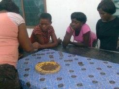 The teacher explains how batik is done