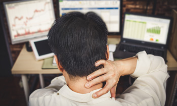 Man tracking charts hand on neck