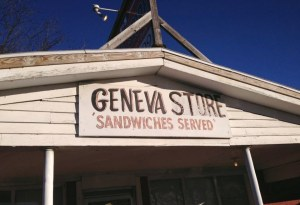 """Hand painted sign reading, """"Geneva Store, Sandwiches Served,"""" photo by Brad Staton"""