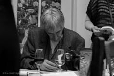 Hendrik Mentz signing a copy of his indie-published book, 'Enter'   photo credit: Oscar O'Ryan
