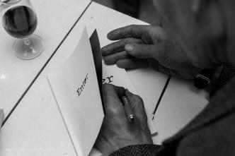 Hendrik signing a copy of 'Enter' | photo credit: Oscar O'Ryan
